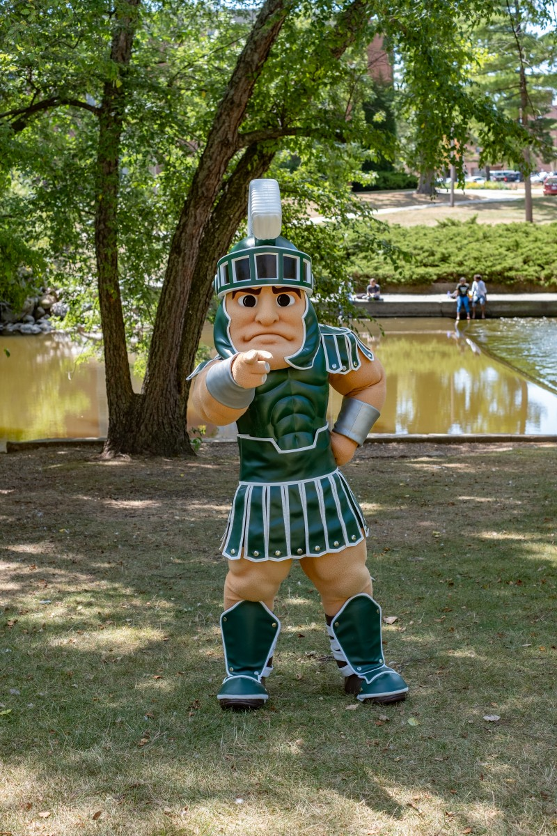 Sparty mascot pointing at the screen